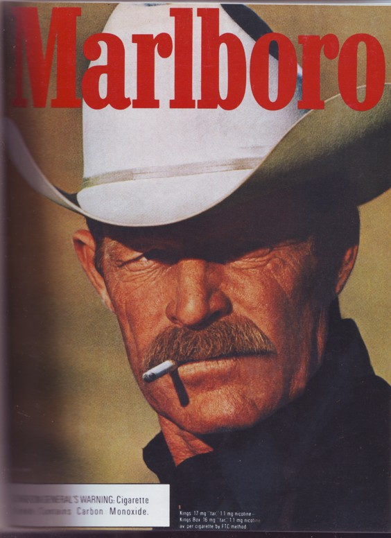 Marlboro-Man. Kernig, mit Schnauz.